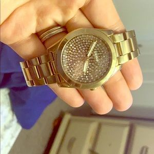 Gold Fossil watch with diamond face
